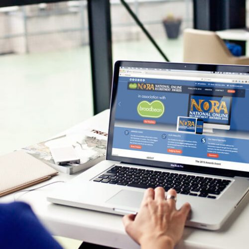 Person looking at NORA website on laptop | Careers Website | That Little Agency